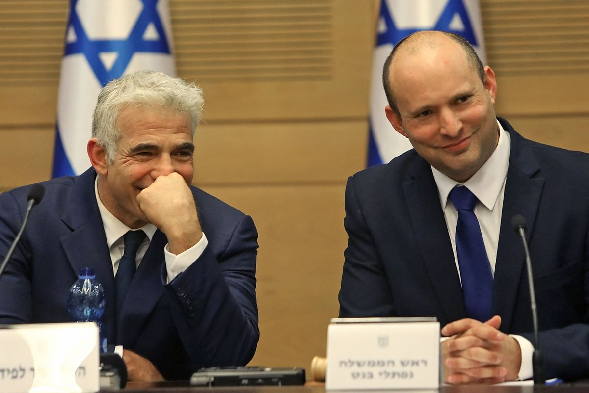 Israels incoming Prime Minister Naftali Bennett and Alternate Prime Minister and Foreign Minister Yair Lapid look on during an address at the Knesset in Jerusalem on June 13, 2021.