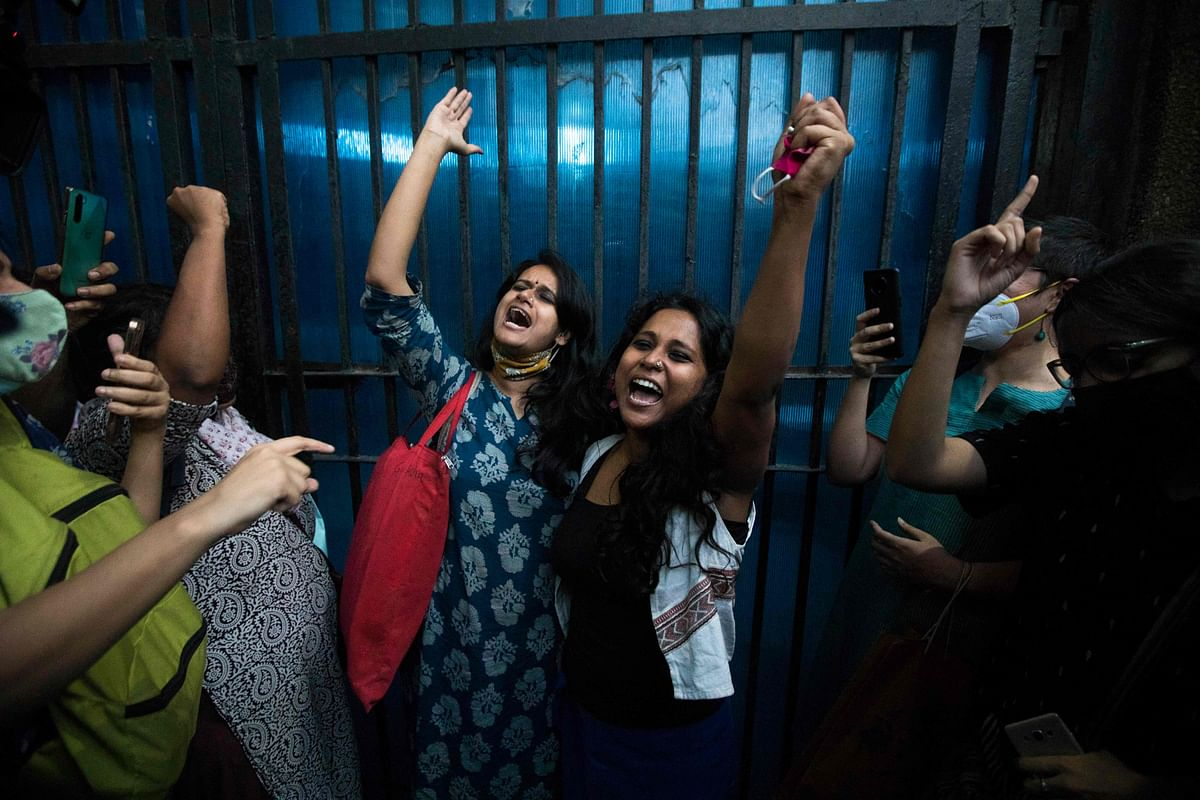 TOPSHOT - Devangana Kalita (C-R) and Natasha Narwal (C-L), student activists who were arrested a year ago in relation to the February 2020 Delhi riots case, shout slogans after being released from Tihar jail in New Delhi on June 17, 2021.