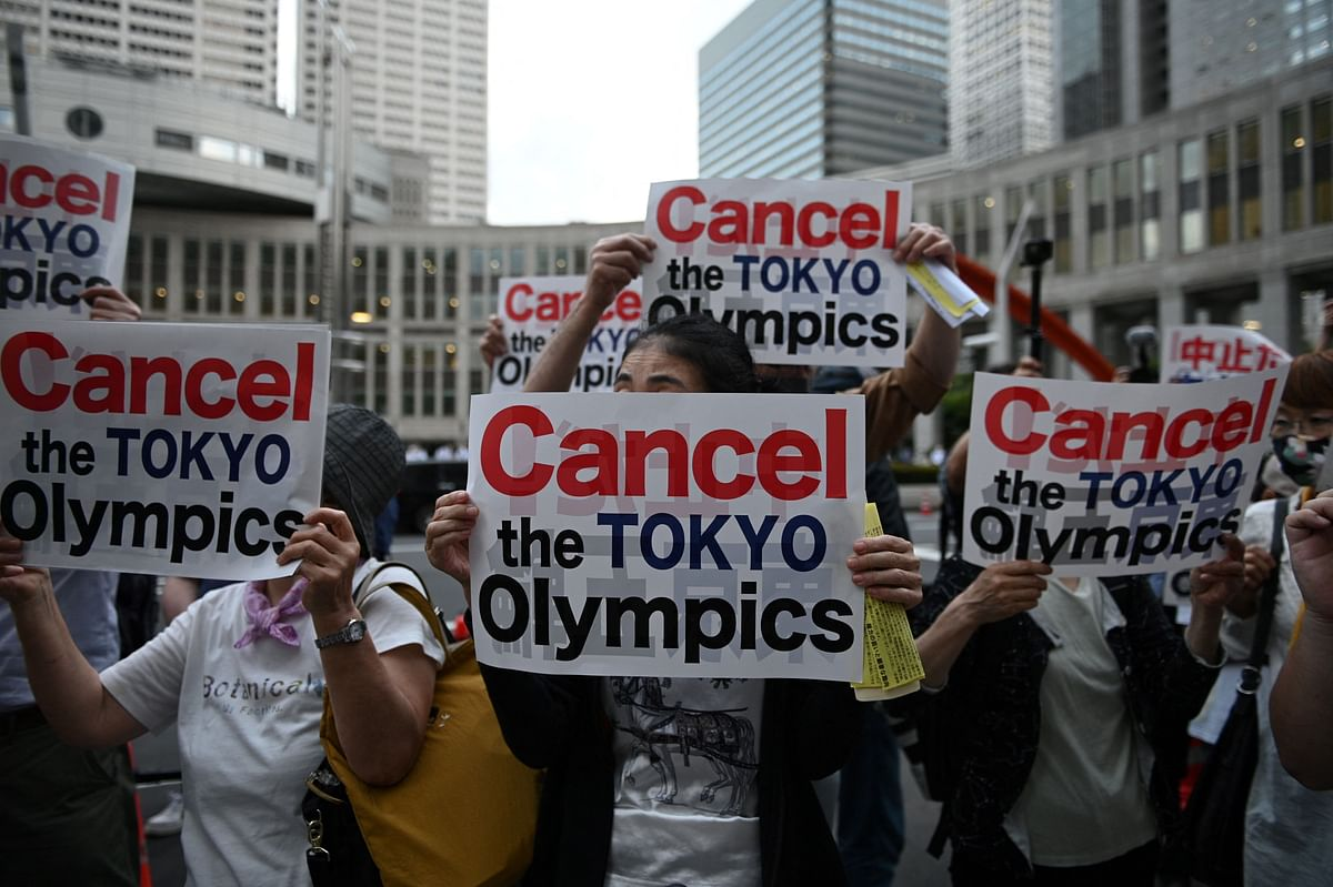 A group of anti-Olympic activists takes part in a protest outside the metropolitan government building to mark the 30 days before the Olympic Games opening ceremonies, in Tokyo on June 23, 2021.
