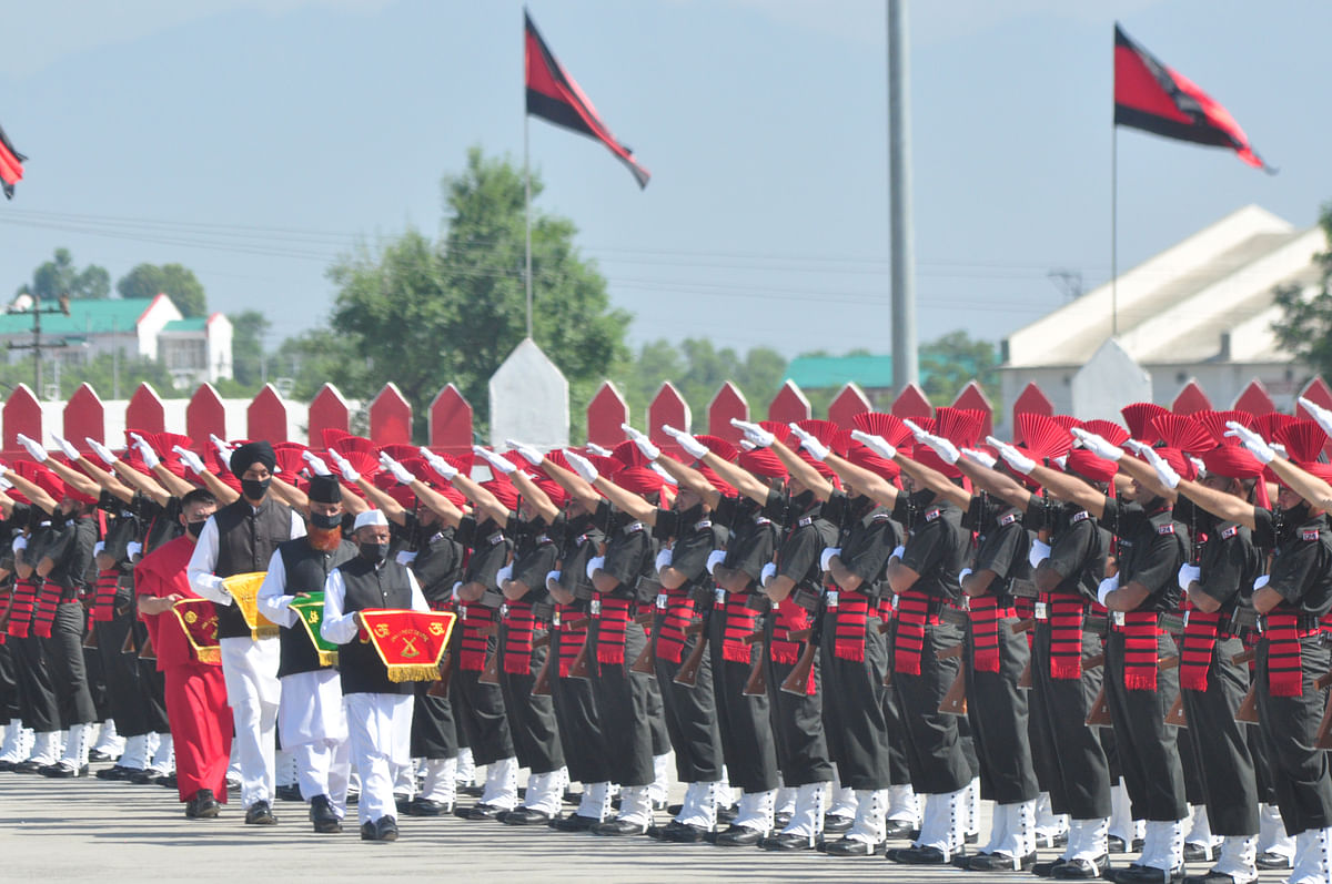 New recruits of the Jammu and  Kashmir Light Infantry Regiment (JKLIR) took oath during the passing out parade in an army base on the outskirts of Srinagar, on Friday, 25 June 2021.