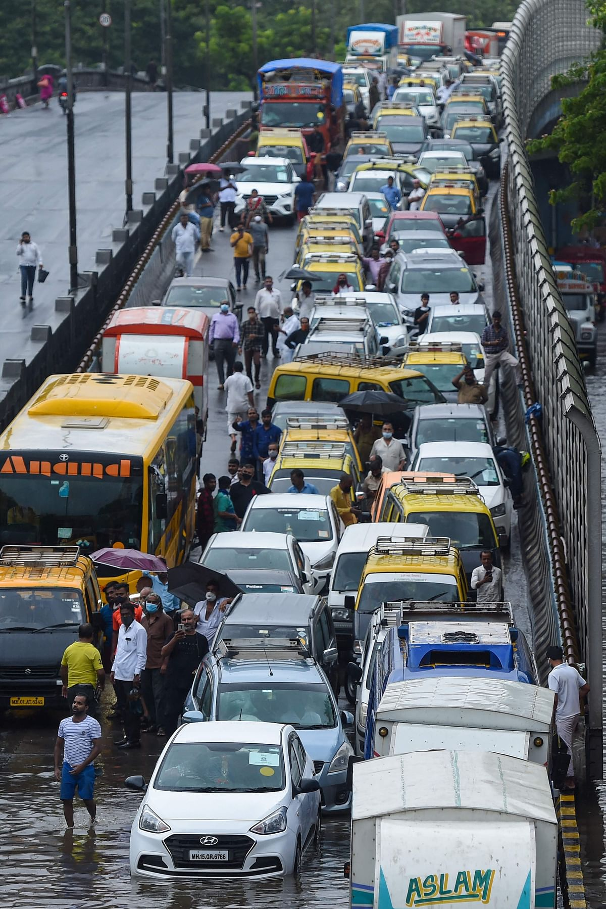 Traffic stands at a stand still on a flooded road following heavy monsoon rains in Mumbai on June 9, 2021.