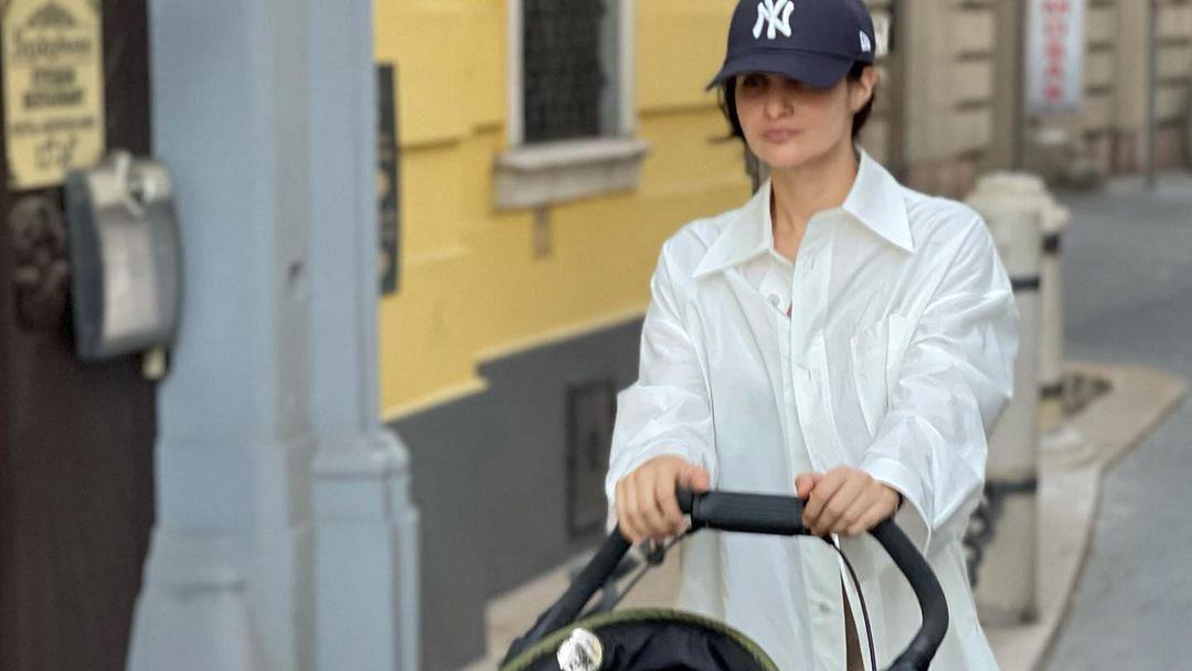 Arjun Rampal's girlfriend Gabriella 'borrows' his shirt to take son Arik for a walk; see pics