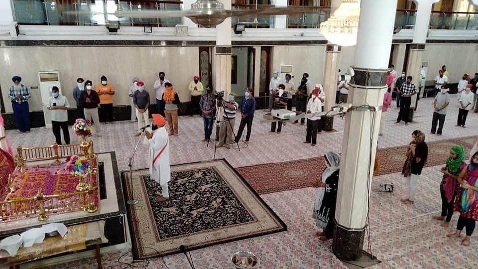 Devotees offering prayers at Imli Sahib Ji gurdwara on Sunday