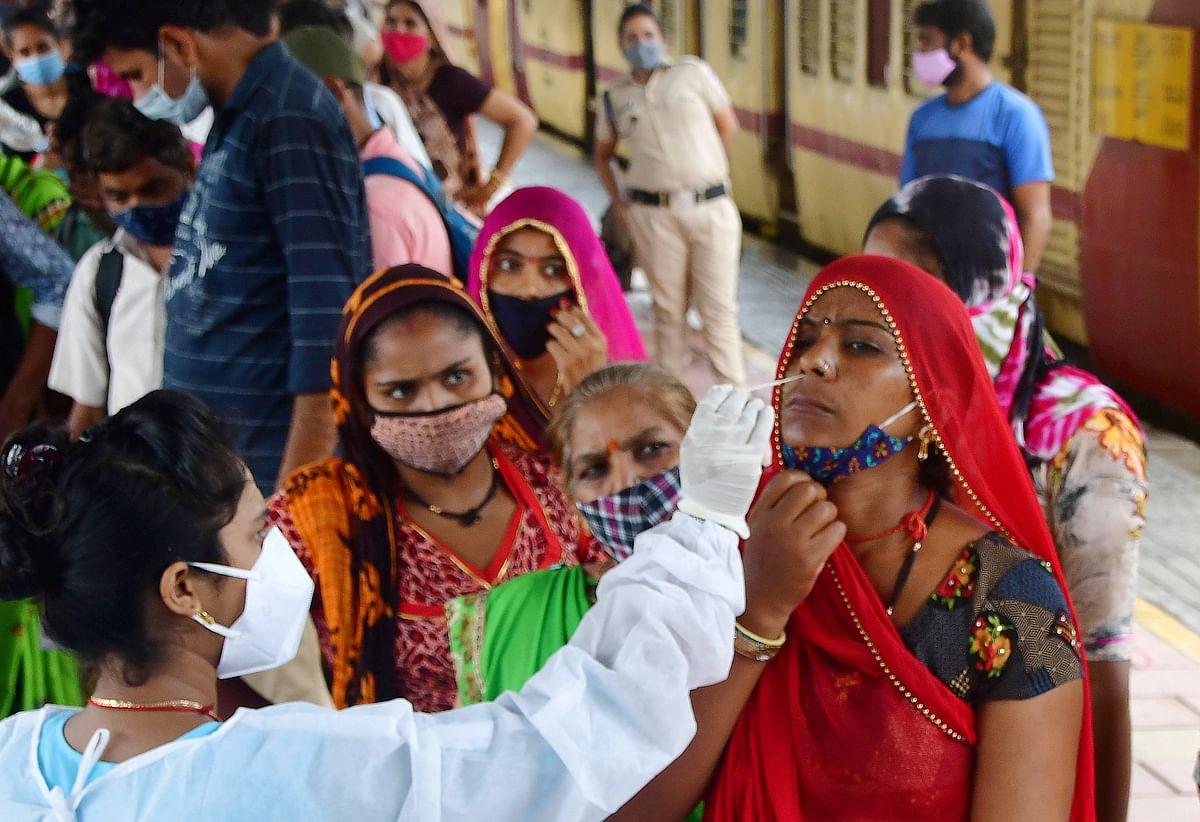 Mumbai: A medic collects nasal sample from a passenger at Dadar station to curb COVID-19 spread in Mumbai, Friday, June 11, 2021.
