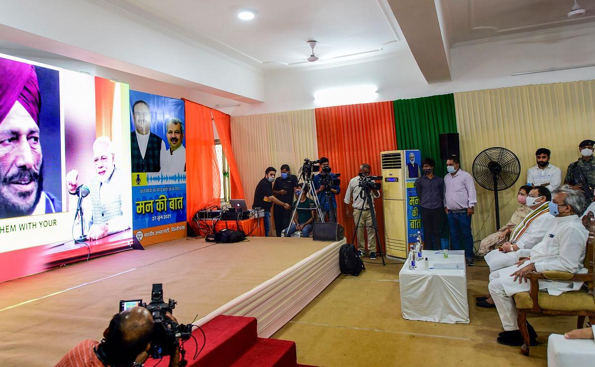 BJP National President JP Nadda (C), partys Delhi President Adesh Gupta (R) and MP Meenakshi Lekhi (L) listen to PM Modis Mann ki Baat in New Delhi, Sunday, June 27, 2021.