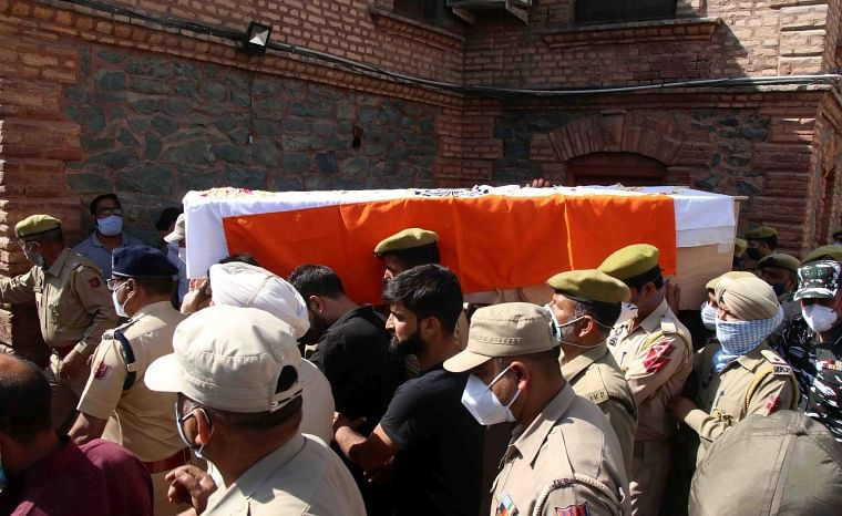 In pictures: Kashmir security officials pay rich tributes to two policemen who lost their lives in Sopore terrorist attack