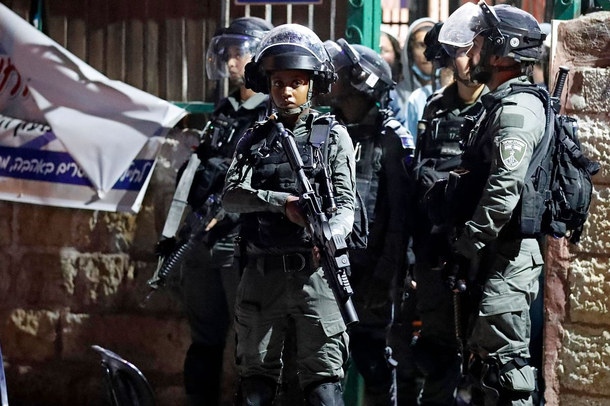 Israeli border guards stand at attention in the east Jerusalem neighbourhood of Sheikh Jarrah on June 21, 2021, during clashes between Israeli far-right extremists and Palestinians.
