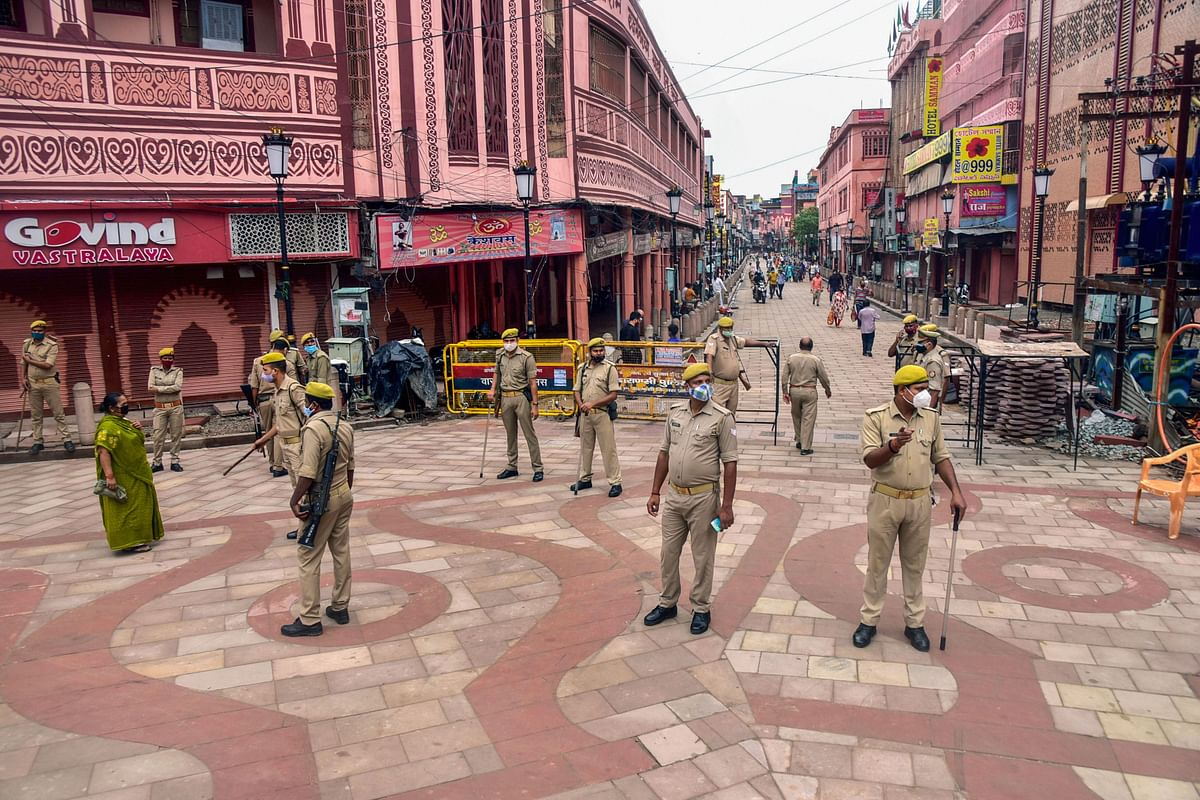 Police personnel deployed to stop devotees coming to offer prayers at Ganga Ghat on the occasion of the Ganga Dussehra festival, in the ongoing Covid-induced lockdown, in Varanasi, Sunday, June 20, 2021.