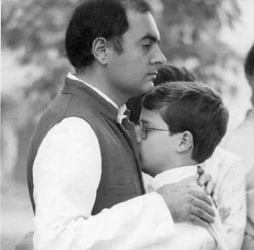 Rahul Gandhi being comforted by his dad at Indira Gandhi's funeral