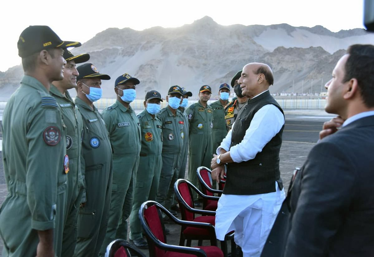 Defence Minister Rajnath Singh interacts with Air Warriors of Indian Air Force at IAF station, in Leh on Monday.
