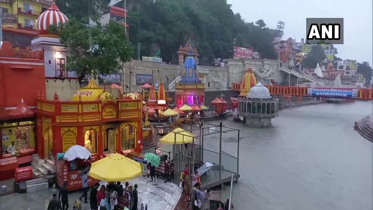 Devotees take holy dip at Har Ki Pauri Ghat, Haridwar in Uttarakhand on Ganga Dussehra on June 20, 2021.
