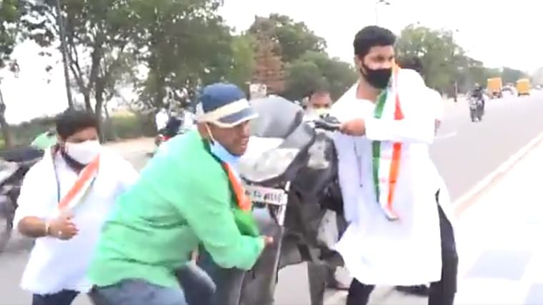 Watch: Telangana Youth Congress workers throw bike into lake to protest against fuel price hike