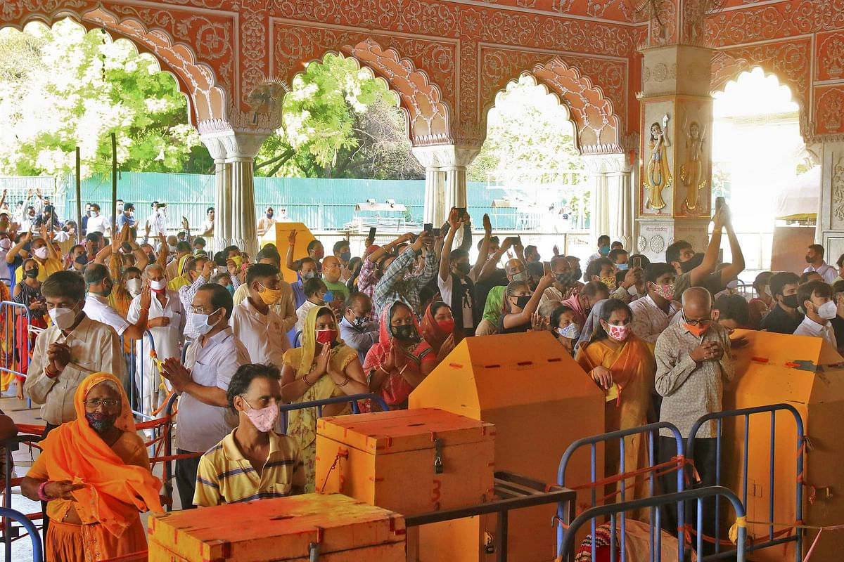 Devotees visit Govind Dev Ji temple after authorities eased COVID-induced restrictions in Jaipur, Rajasthan on Monday, June 28, 2021.