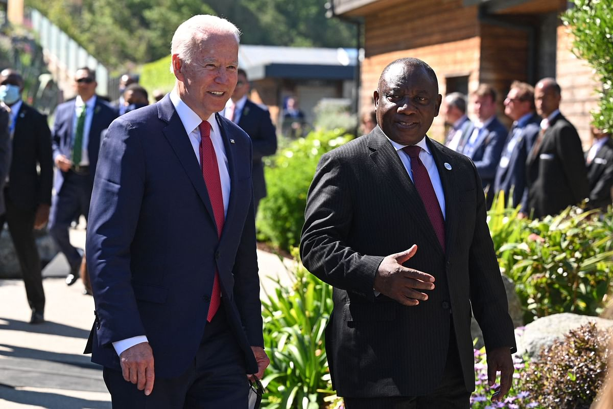 US President Joe Biden (L) speaks with South Africas President Cyril Ramaphosa (R) as they attend the G7 summit in Carbis Bay, Cornwall on June 12, 2021.