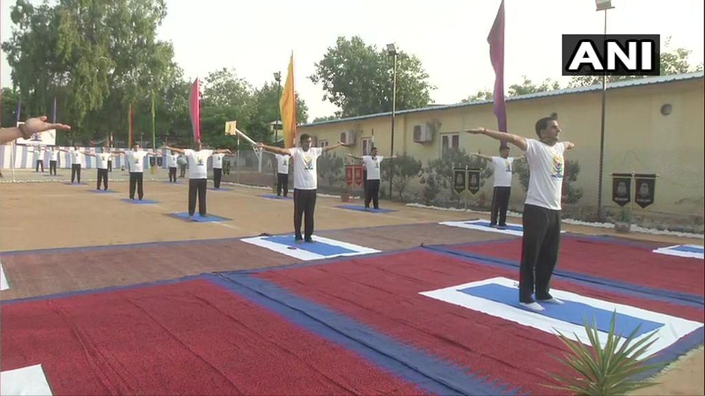 Jammu and Kashmir: CRPF personnel perform Yoga in Jammu, on International Day Of Yoga.