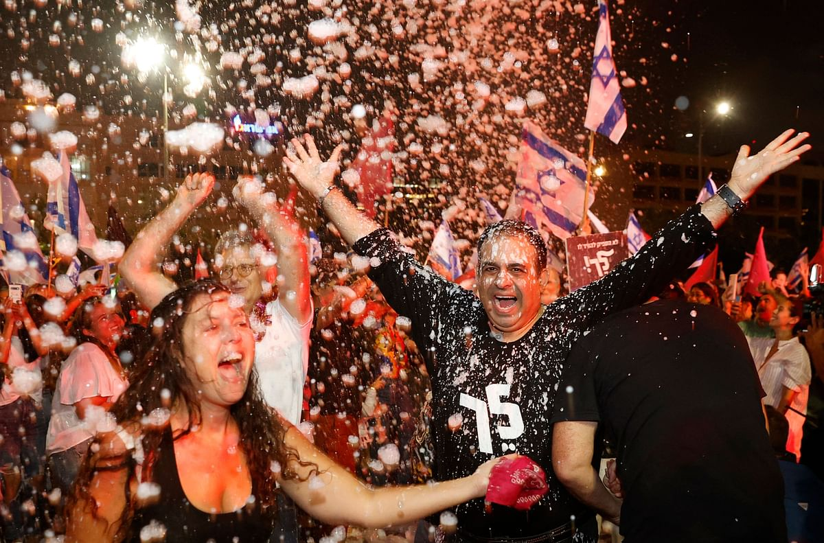 Israel erupts into celebration as new coalition takes over from Benjamin Netanyahu's govt; see pictures