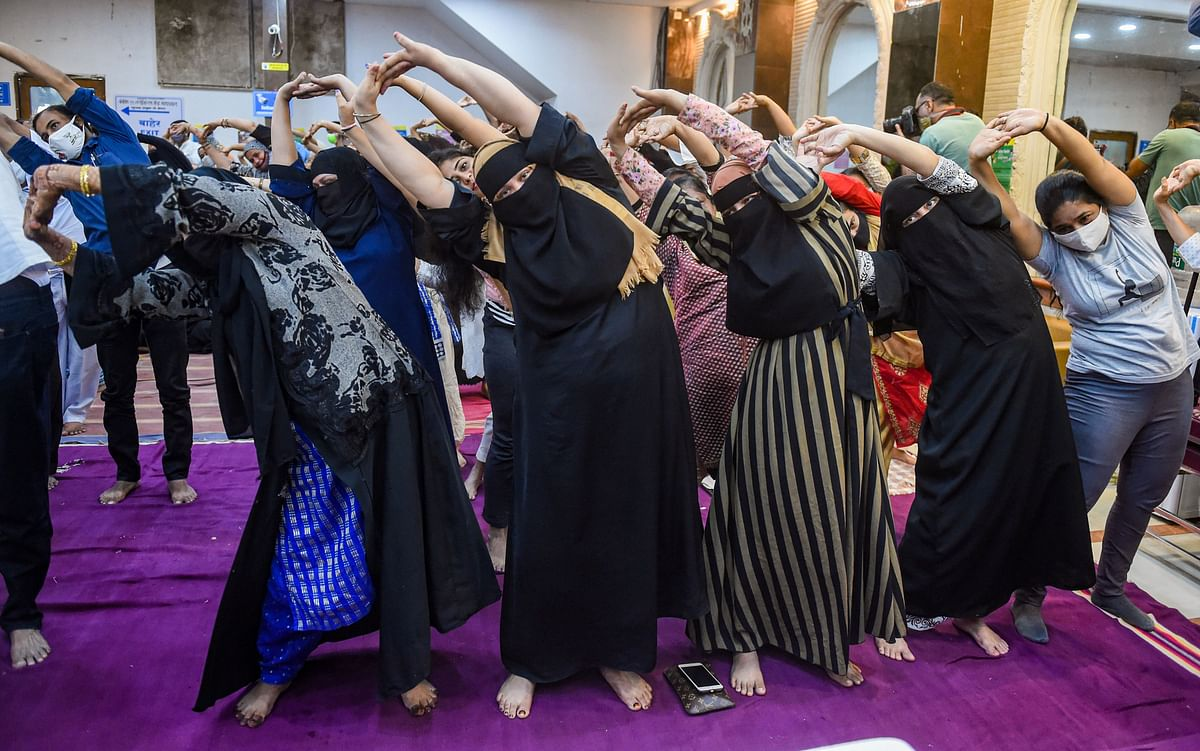 Mumbai: Muslim Community women perform Yoga on International Day of Yoga, in Mumbai, Monday, June 21, 2021.