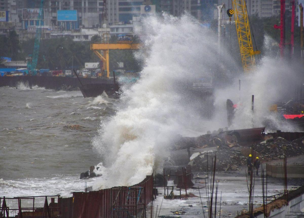 Sea waves crash ashore during high tide, at Marine Drive in Mumbai, Tuesday, June 15, 2021.