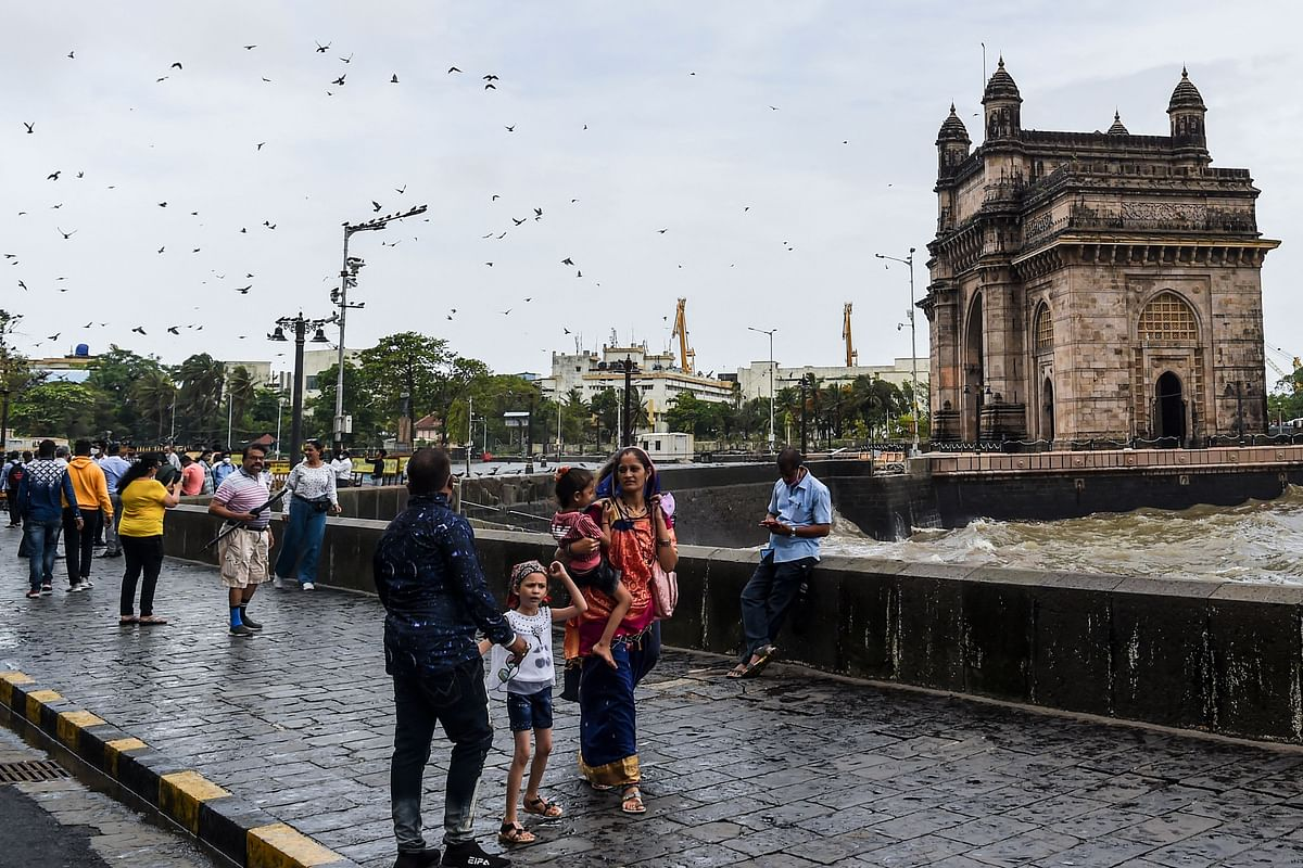 Tourists gather near the Gateway of India in Mumbai on June 16, 2021.