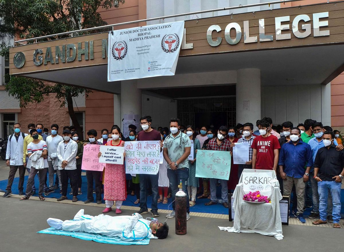 Junior doctors demonstrate after their mass resignation demanding a hike in the salaries, at Gandhi Medical College, in Bhopal, on Sunday. A division bench of Madhya Pradesh High Court declared the state-wide strike by junior doctors as illegal and ordered them to resume their duty within 24 hours.