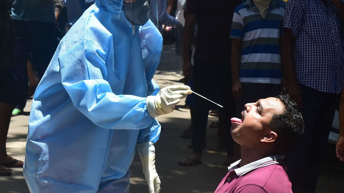 India reports 84,332 new COVID-19 cases, lowest in 70 days