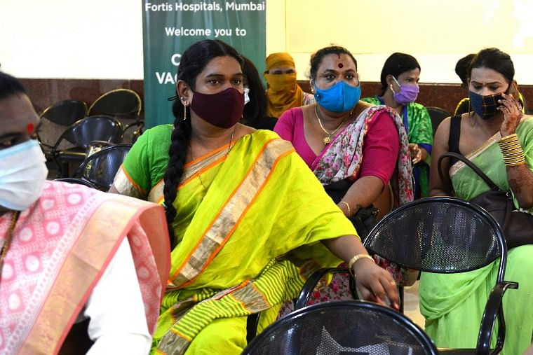 Members of the transgender community wait to get themselves inoculated with the Covid-19 coronavirus vaccine at a hospital in Mumbai on June 20, 2021