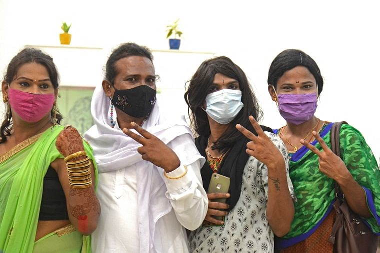 Members of the transgender community pose for a photograph after getting themselves inoculated with the Covid-19 coronavirus vaccine at a hospital in Mumbai on June 20, 2021