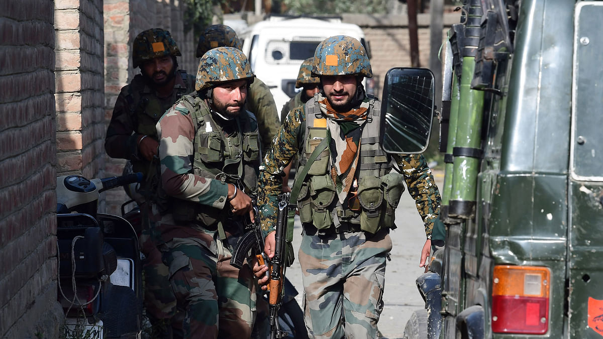 Jammu and Kashmir, June 28 (ANI): Army personnel cordon off during the encounter between militants and security forces, in Srinagar on Monday.