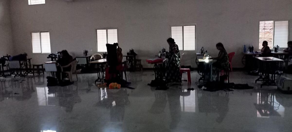 Women stitching uniforms in dark as Ajivika Bhavan in Bagh has no electricity