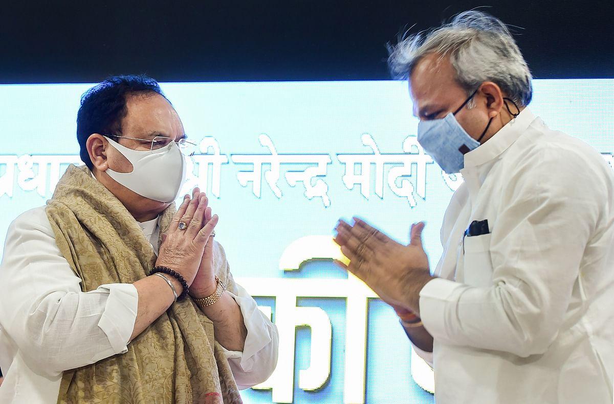 BJP National President JP Nadda (L) gestures to partys Delhi President Adesh Gupta (R) during PM Modis Mann ki Baat in New Delhi, Sunday, June 27, 2021.