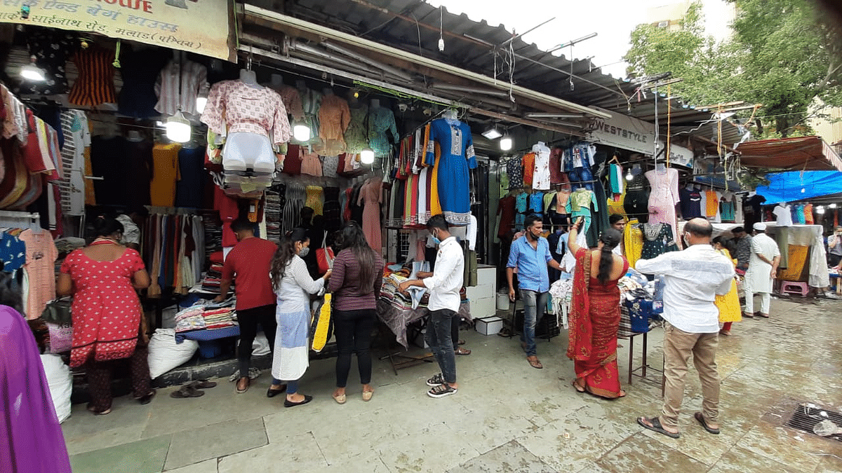 People were seen shopping at the Municipal market in Malad, Mumbai on Monday after the government announced the easing of COVID-induced restrictions.