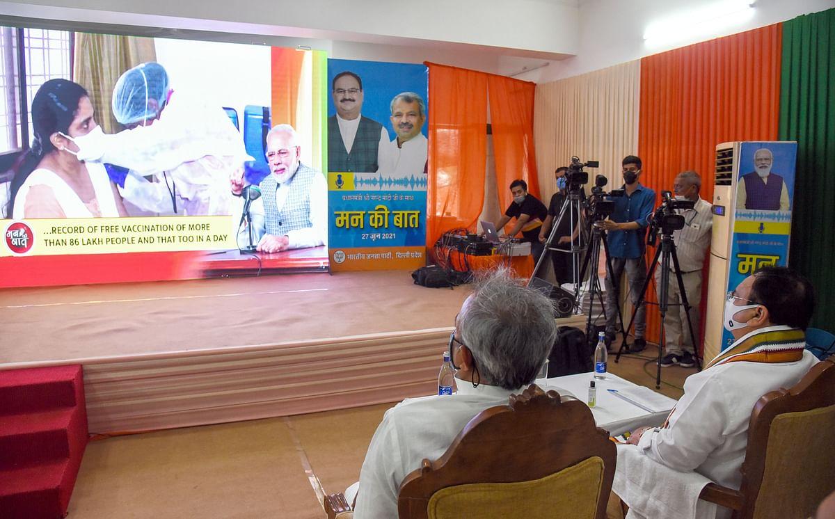 BJP National President JP Nadda along with party President Adesh Gupta listen to Prime Minister Narendra Modis Mann ki Baat, in New Delhi on Sunday.