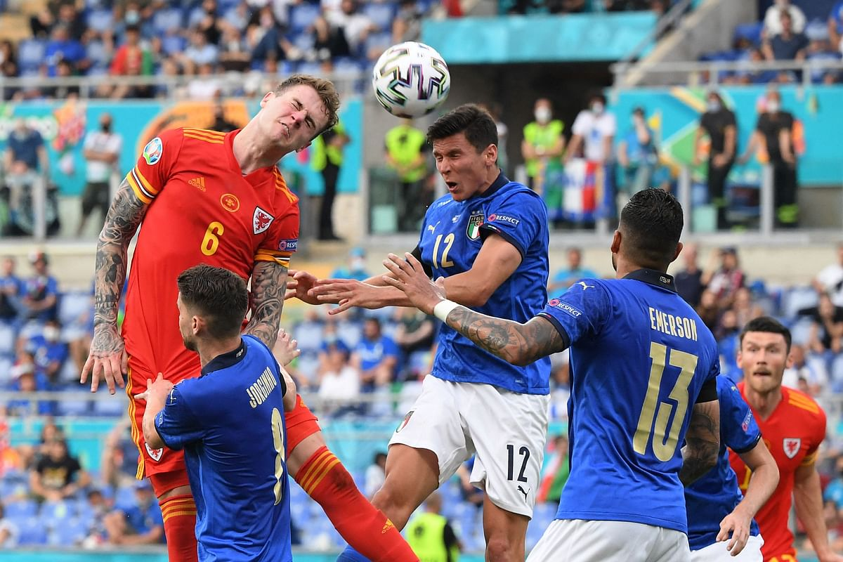 Wales defender Joe Rodon (L) vies for the header with Italys midfielder Matteo Pessina (C) during the UEFA EURO 2020 Group A football match between Italy and Wales