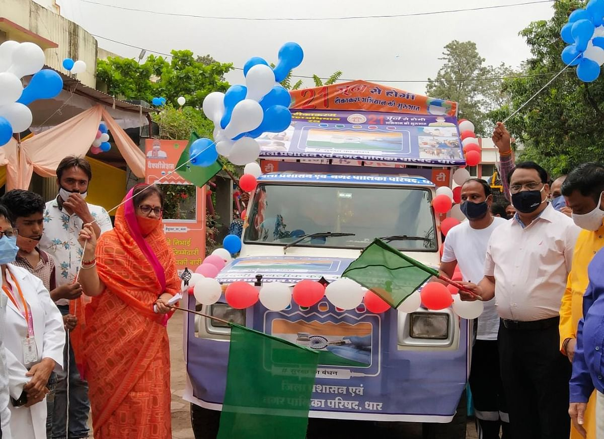 Dhar MLA Neena Verma and Dhar district collector Alok Kumar Singh flagged off mobile vaccination van to launch the drive