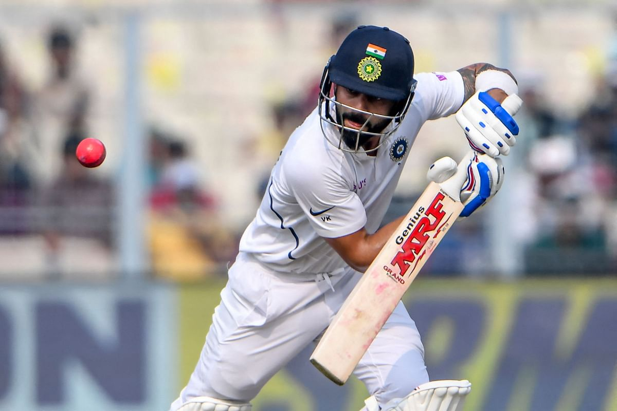 In this file photo taken on November 23, 2019 Indias captain Virat Kohli plays a shot during the second day of the second Test cricket match of a two-match series between India and Bangladesh at the Eden Gardens cricket stadium in Kolkata. - India face New Zealand in the inaugural World Test Championship final on Friday in a match that could have a profound influence on cricket globally.