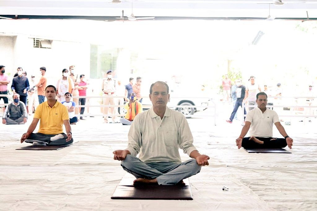 Bhopal, Indore come alive after pandemic gloom as chief minister, people perform asanas on Yoga Day, join vaccination drive