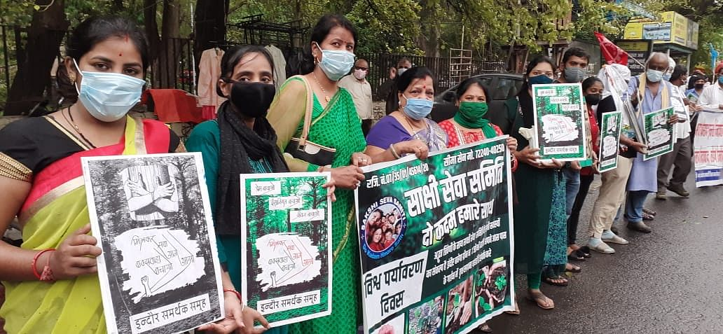 People from all walks of life stood with placards forming a human chain in front of divisional commissioner's office protesting against mining project resulting in clearing of 382.131-hectare patch of the protected Buxwaha forest.