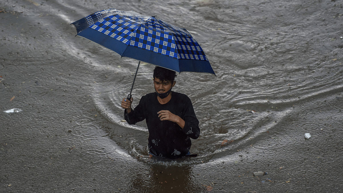 Mumbai: Children play in waterlogged streets, heavy rains cause traffic snarls- see photos and videos