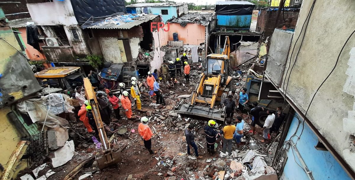 Rescue operation underway after a single-storey house collapsed on another structure in Malwani area on Wednesday night, in Mumbai, Thursday, June 10, 2021. At least eight children and three adults were killed and seven other people injured in the mishap.