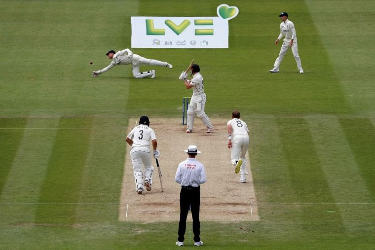 Englands James Bracey (top L) fails to make a catch off the batting of New Zealands Henry Nicholls (C) on the fifth day of the first Test cricket match between England and New Zealand at Lords Cricket Ground in London on June 6, 2021