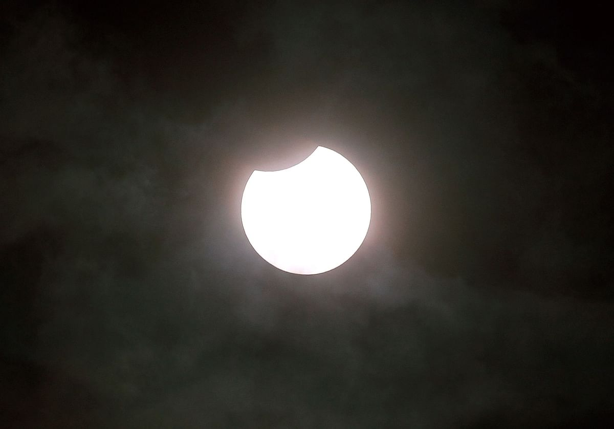 A picture taken on June 10, 2021 shows a partial solar eclipse, pictured in Gaiberg near Heidelberg, southwestern Germany, on June 10, 2021.