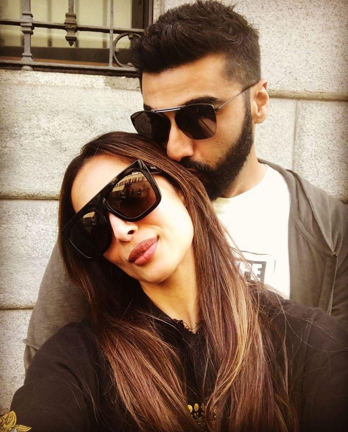 Arjun Kapoor and Malaika Arora sharing a sweet moment