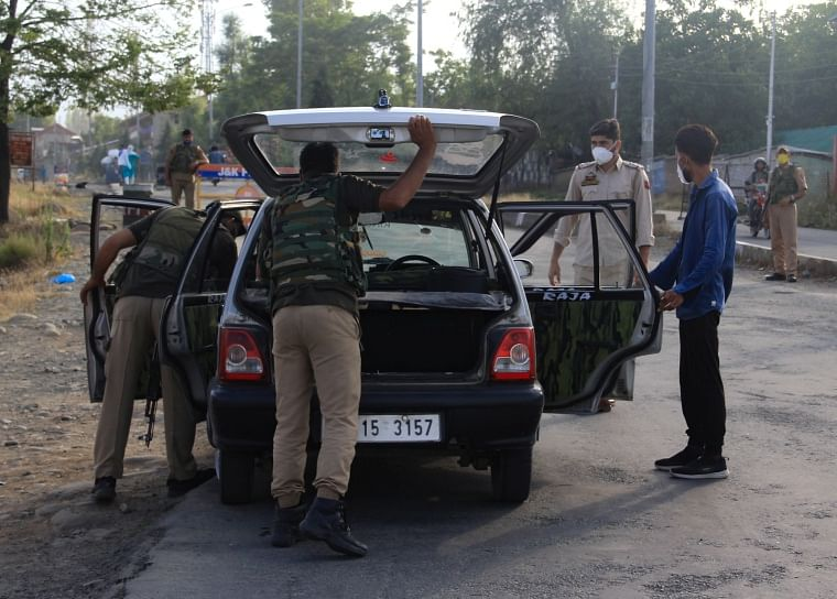 CRPF personnel conduct search in a car