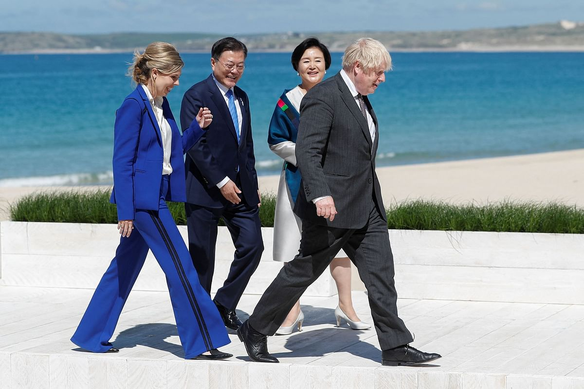 Britains Prime Minister Boris Johnson (R) and his wife Carrie Johnson (L) greet South Koreas President Moon Jae-in (2nd L) and his wife Kim Jung-sook (2nd R) during an official welcome during the G7 summit in Carbis Bay, Cornwall on June 12, 2021.