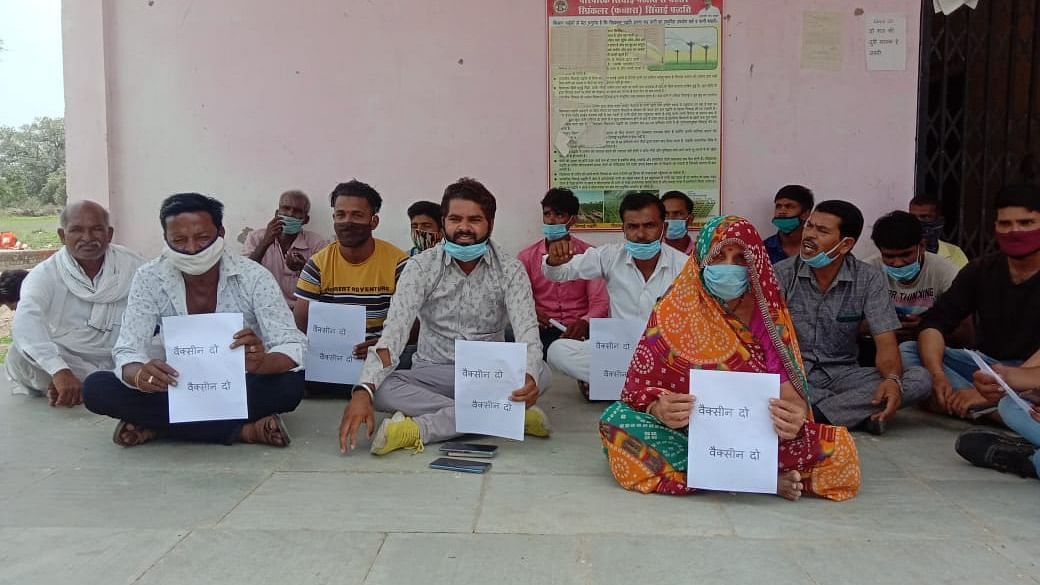 Madhya Pradesh: Villagers in Alot invited with yellow rice fail to get jabs, stage protest outside Panchayat Building