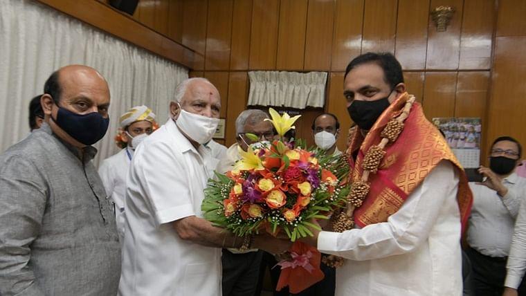 Karnataka CM BS Yediyurappa greets Maharashtra Water Resources Minister Jayant Patil.