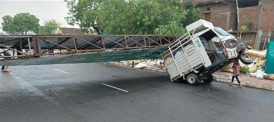 A billboard fell on a passing loading rickshaw during the rain on MR 4 road.