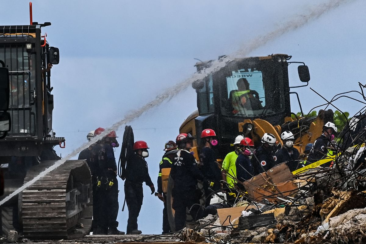 Rescue workers continue to search the rubble at the site of a collapsed building in Surfside, Florida, north of Miami Beach, on June 26, 2021.