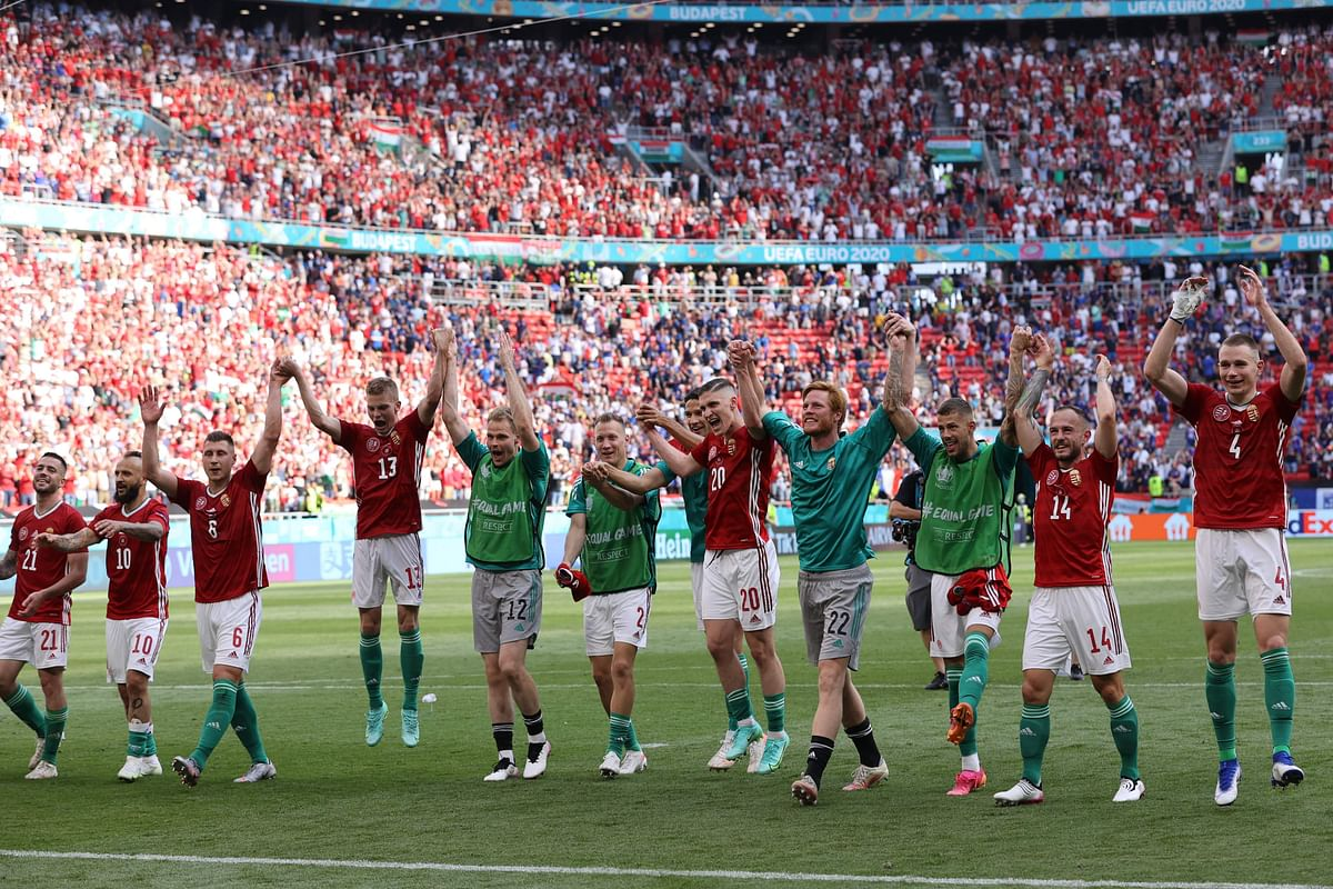 Hungarian team celebrate with the crowd after holding world champions France to a 1-1 draw