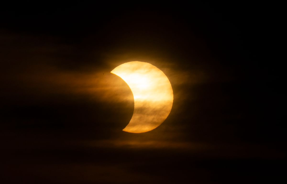 A eclipsed sun rises over New York City on June 10, 2021 seen from Jersey City, New Jersey.